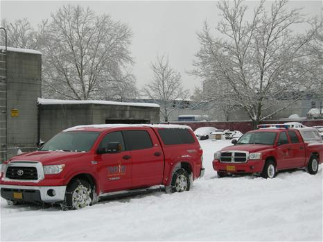 Red Trucks in Winter Storm