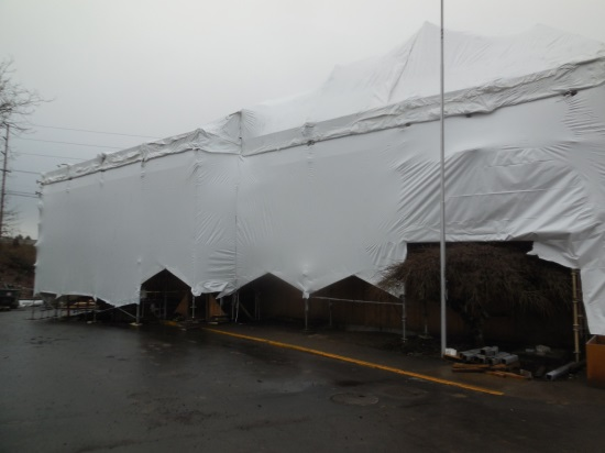 Tent covering Station 64 during construction