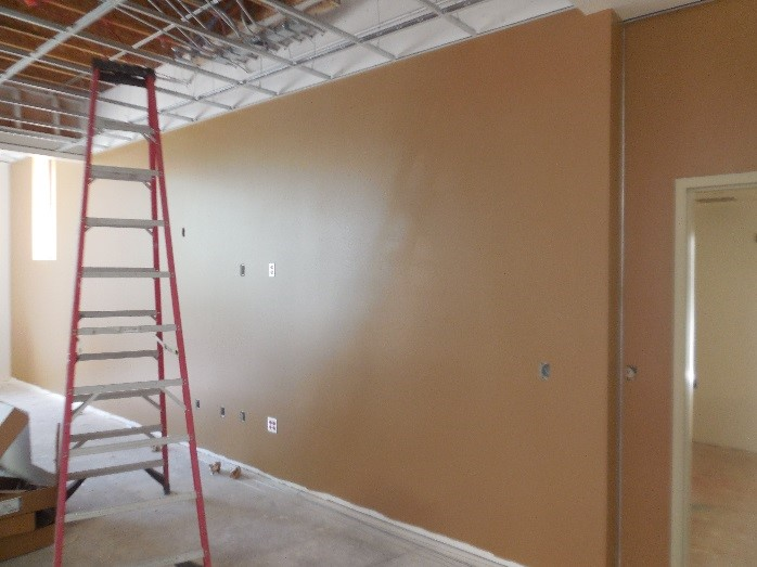 Painting interior walls at Station 64