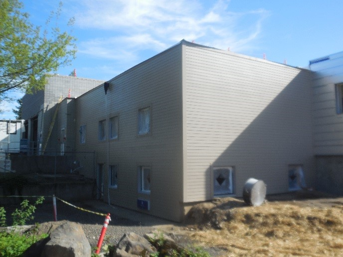 Exterior siding construction at Station 64