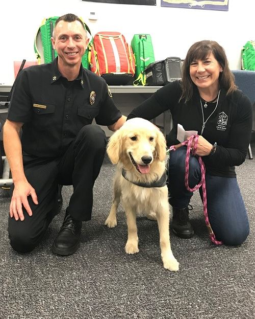 Fire Marshal Steve Forster with a golden retriever shares message that fireworks scare pets