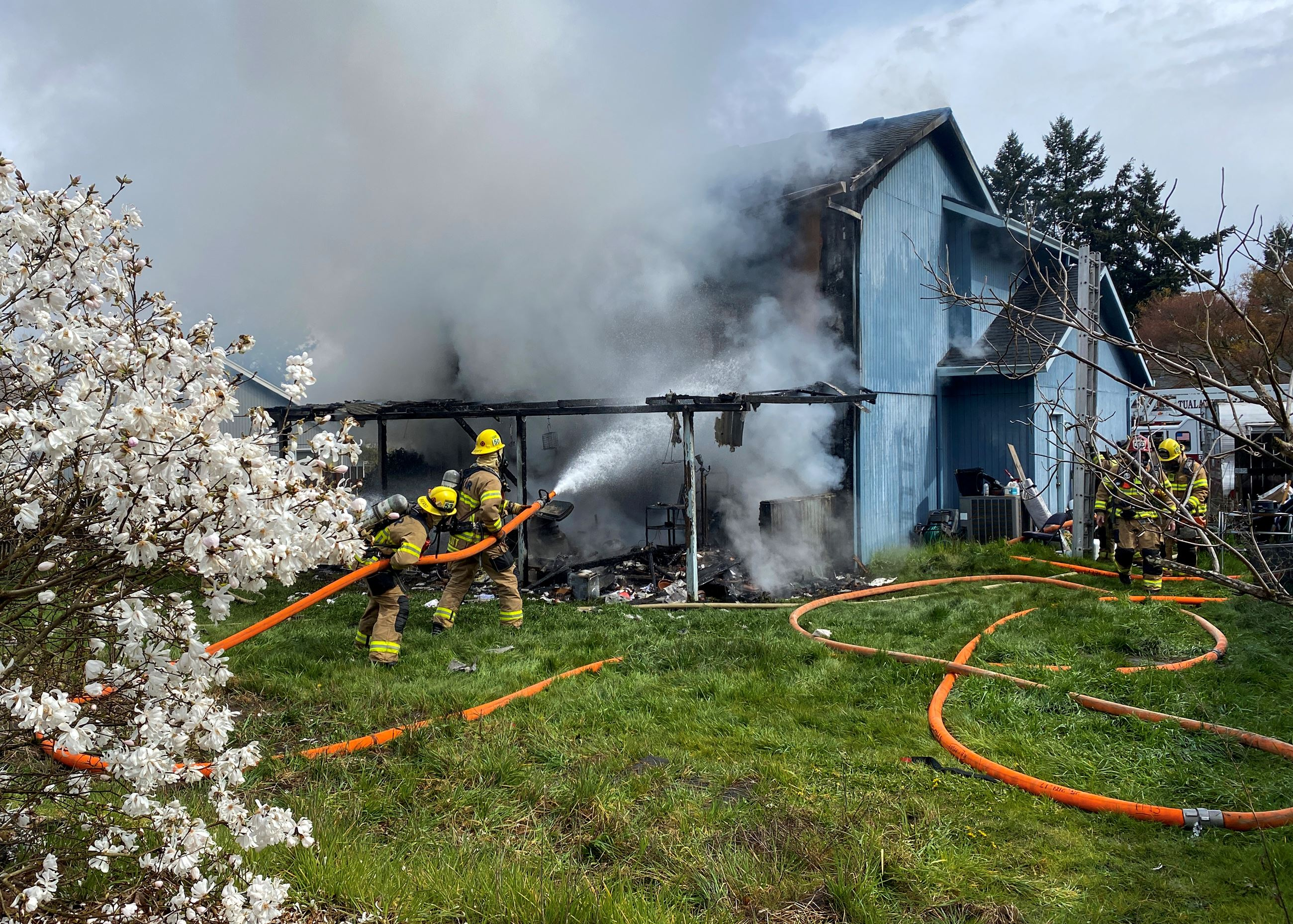 Firefighters work to extinguish Tigard house fire
