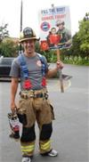 Firefighter Holding Fill the Boot Sign