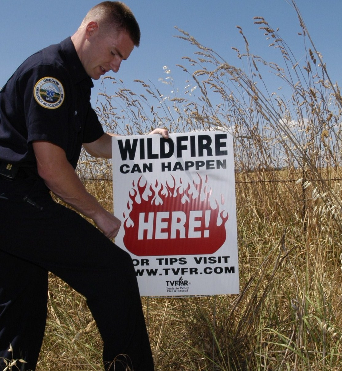 crew with wildfire sign cropped.jpg